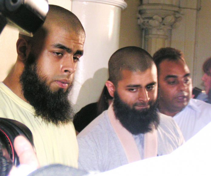 The two brothers ABUL KOYAIR and MOHAMMED ABDUL KAHAR, who suffered throughout the press conference from the effect of his injuries