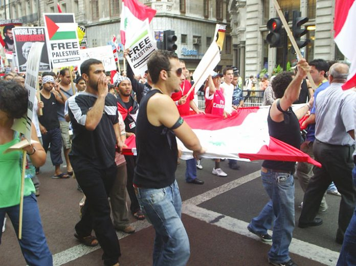 Marchers carrying the Lebanese flage denounce the US and Israel on last Saturday's 30,000-strong march in central London