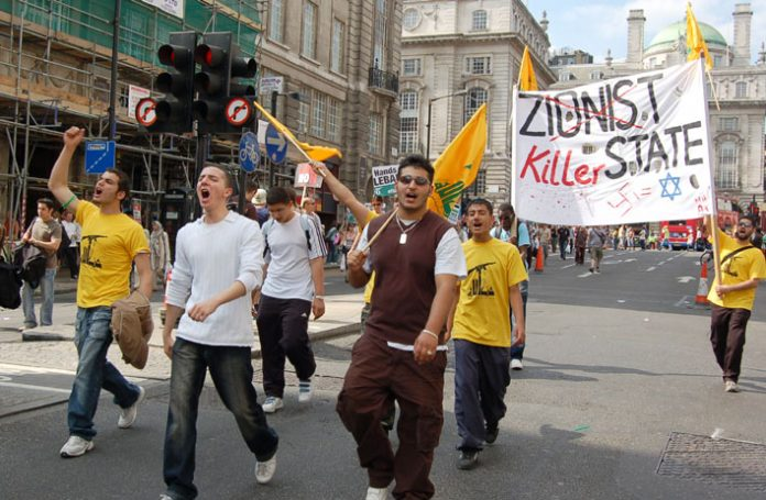 Youth denouncing the 'Zionist killer state' marching in London on Saturday's 100,000-strong demonstration against the Israeli aggression