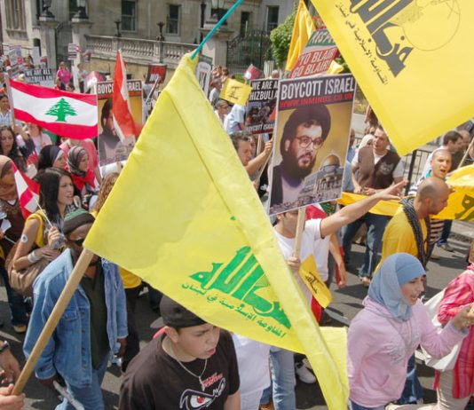 Hezbollah flags on a section of the 100,000-strong London demonstration on August 5th against Israel's attacks on Lebanon and Gaza