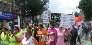 Gate Gourmet locked out workers leading yesterday's 600-strong 1st Anniversary march through Southall