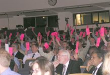 Doctors at the British Medical Association Annual Representative Meeting in June voting to keep privateers out of the NHS