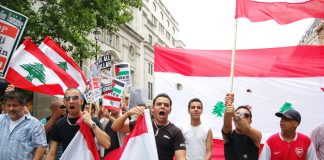 Angry Lebanese youth marching with their flags in London on July 22