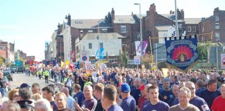 A section of the 7,000-strong march makes its way through Liverpool last Friday