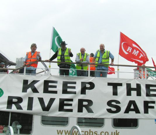 BOB CROW (right) with Thames watermen. He warned that a 'dilution of safety' would be met with industrial action