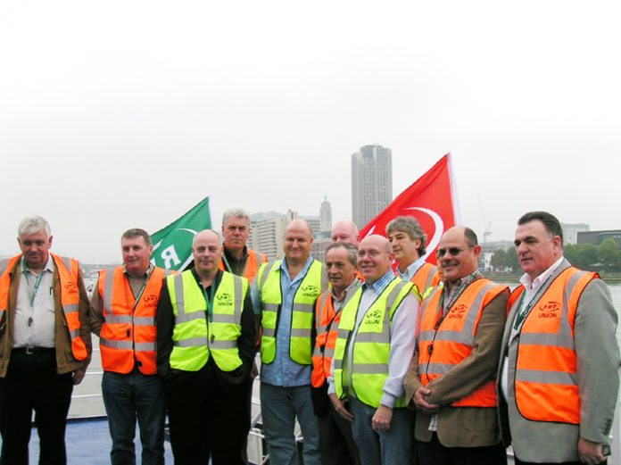 RMT leader BOB CROW (fifth from left) with RMT Thames Watermen aboard the 'Keep the River Safe' campaign boat