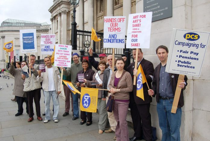 PCS members on the picket line outside the National Gallery yesterday, determined to defend their pay and conditions