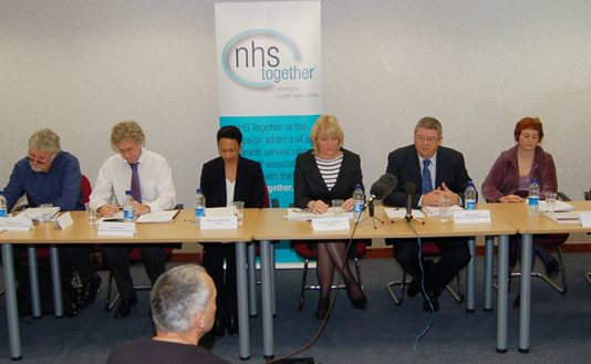 The  platform at the 'NHS Together' press conference on Tuesday
