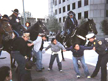 Mounted police assault on the Houston janitors non-violent protest outside the investment bankers JP Morgan Chase buildings – 44 janitors were arrested and four injured