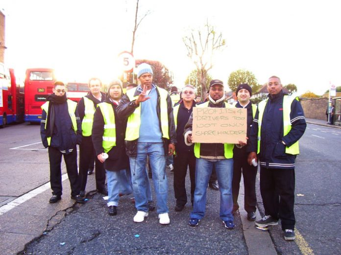 Striking Metroline TGWU drivers and engineers on the picket line at Willesden bus garage last Tuesday