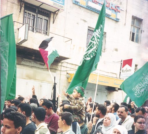Palestinian and Hamas flags on a demonstration in Ramallah against the Israeli occupation