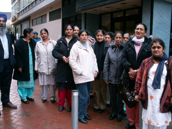 A group of the locked-out Gate Gourmet workers outside the Employment Tribunal in Reading
