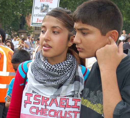 Young girl on a demonstration in London against the Israeli war on the Lebanon with a clear message