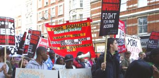 Young Socialists banner on the NUS October 29th demonstration demanding fees are scrapped not capped