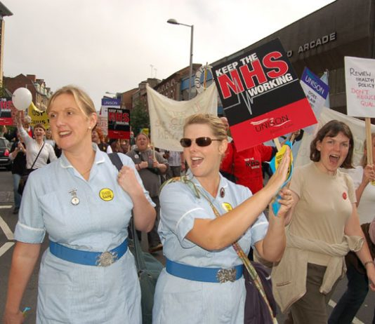 Nurses marching against NHS cuts in Nottingham on September 23