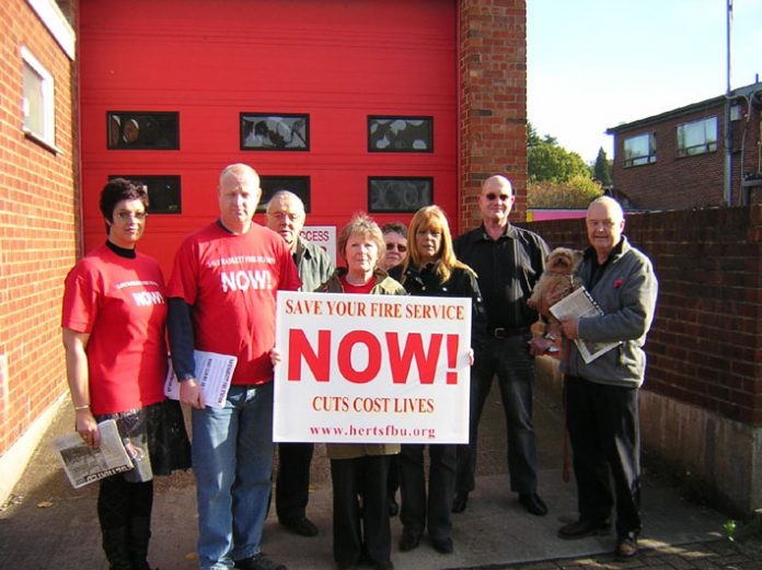 Campaigners fighting against cuts to the Herts fire service outside Radlett fire station in Ocober