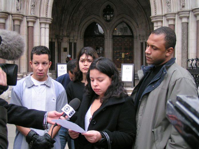 Cousins of Jean Charles De Menezes, ALEX PEREIRA (left) and PATRICIA da SILVA ARMANI (speaking) outside the High Court yesterday