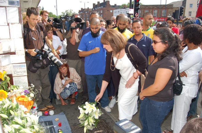 Vigil outside Stockwell Tube station on July 22nd, a year after Jean Charles de Menezes was shot dead by police as he boarded a tube train