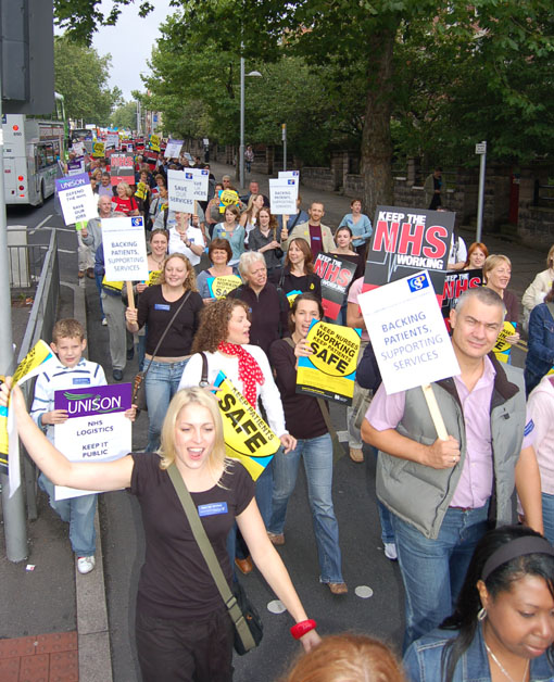 Members of the Chartered Society of Physiotherapists with their placards marching against cuts in Nottingham