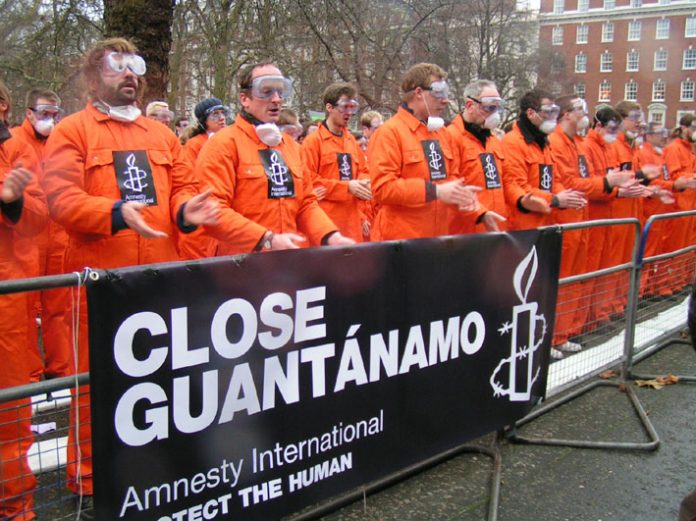 More than 500 demonstrators dressed in boiler suits to symbolise the hundreds of people still held in Guantanamo Bay. Part of a worldwide demonstration taking place five years after the camp was opened