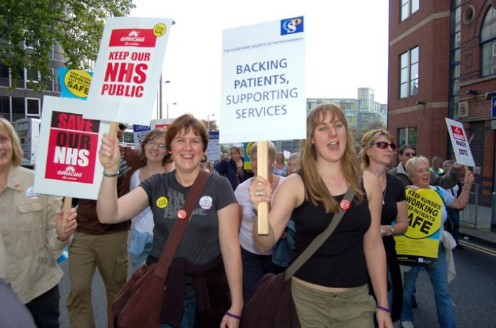 Demonstrating health workers opposing the government's privatisation of the NHS marching through Nottingham last September