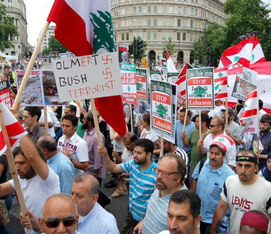 Demonstrators in London on July 27 last year condemn Olmert and Bush for their crimes in Lebanon