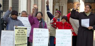 Chagossians in defiant mood outside the Royal Courts of Justice in the Strand on Monday, including Hengride Permal (right)