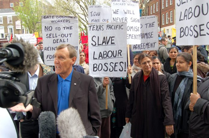 TGWU general secretary TONY WOODLEY surrounded by sacked Gate Gourmet workers angry at the sell-out 'Compromise Agreement' made between the TGWU leaders and Gate Gourmet bosses