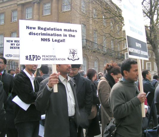 Overseas doctors picket Downing Street after the government changed the rules of their employment last April