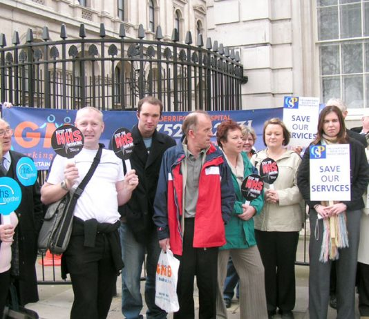 Trade unionists and local campaigners fighting the massive cuts at Derriford Hospital in Plymouth outside Downing Street yesterday, where they handed in a 12,000-strong petition against 60 more bed closures in a £25m cuts package