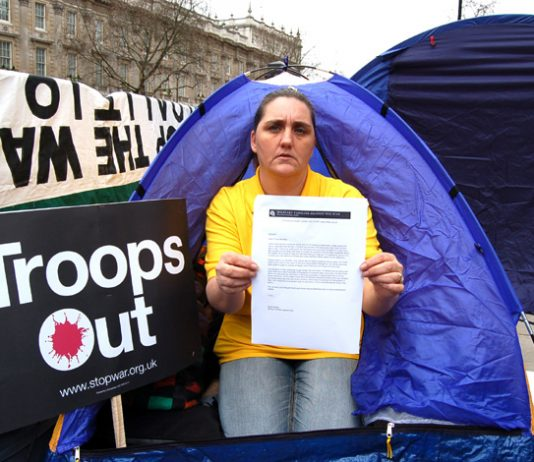 Rose Gentle at the Military Families Against the War Camp opposite Downing Street, yesterday with a letter demanding Blair meet the families