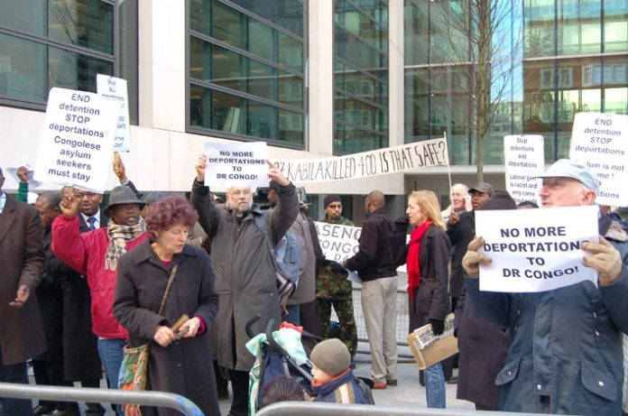 Demonstrators outside the Home Office yesterday demanding the government halts a charter flight that was due to take off to Democratic Republic of the Congo (DRC) last night, with worries that those being dispatched to the DRC would be in grave danger and