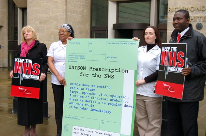 UNISON Head of Health KAREN JENNINGS (left) with other UNISON members handing in the UNISON prescription for the NHS to the Department of Health yesterday mid-day