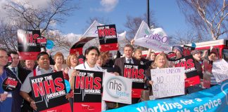 UNISON General Secretary Dave Prentis (centre) protesting with hospital workers outside Kingston Hospital in Surrey yesterday