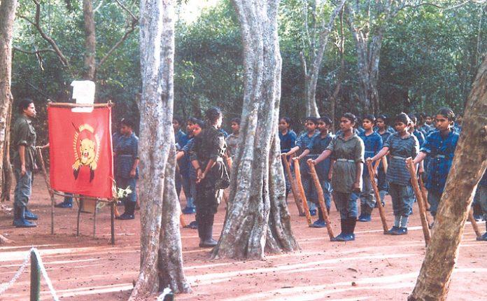 Female Tamil Tigers drill in the jungle