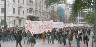 Students with their banners marching in Athens