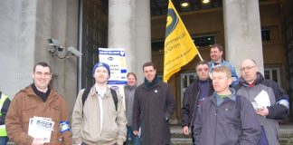 Mark Serwotka, PCS leader (centre), with a group outside the Ministry of Defence yesterday morning