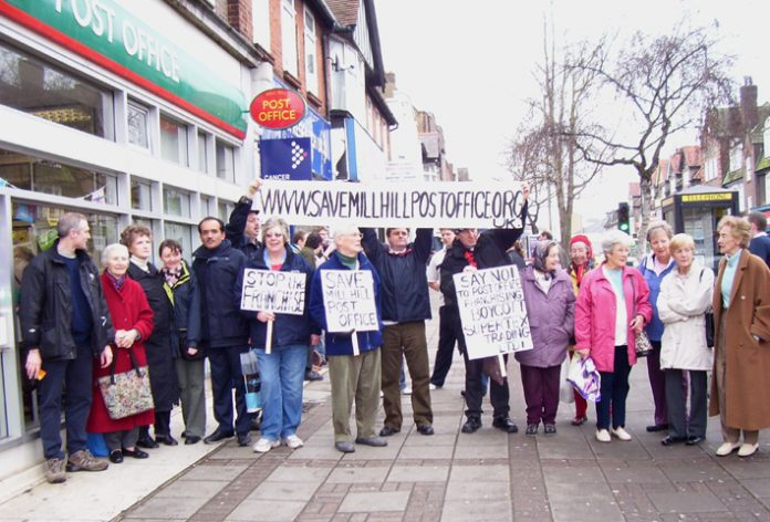 Postal workers and local residents protest against the closure of Mill Hill Post Office in north London