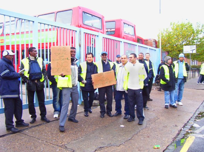 Mass picket by bus workers during strike action at Metroline bus company in west London last November