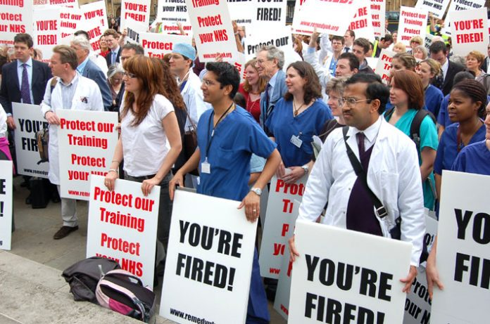 Hundreds of angry doctors at yesterday's rally outside parliament against the government's assault on their jobs and training