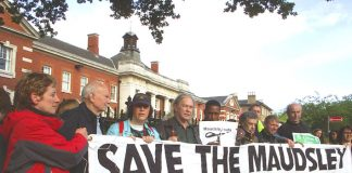 The 'Save The Maudsley Emergency Clinic' banner is unfurled at Saturday evening's demonstration outside the hospital