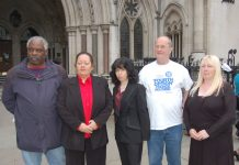 Parkside estate tenant CAROL SWORDS (second from left) with supporters outside the High Court yesterday morning
