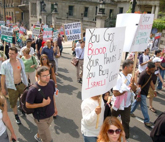 Marchers in London on August 5th last year against Israel's bombing of Lebanon demand a boycott of Israeli goods