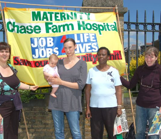 From the left: Midwifery assistant MARIA SUAREZ, a young mother, and North East London Council of Action members ROSETTA REEVES  and ANNA ATHOW on yesterday's picket of Chase Farm Hospital