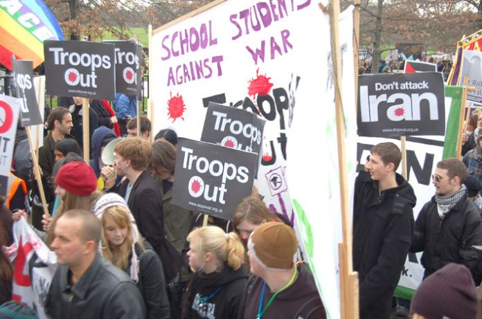 School students marching in London last February demanding the withdrawal of British troops from Iraq
