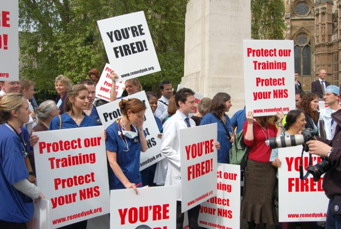 Junior doctors lobbying parliament against the government's 'reforms' which will cut 18,000 training posts