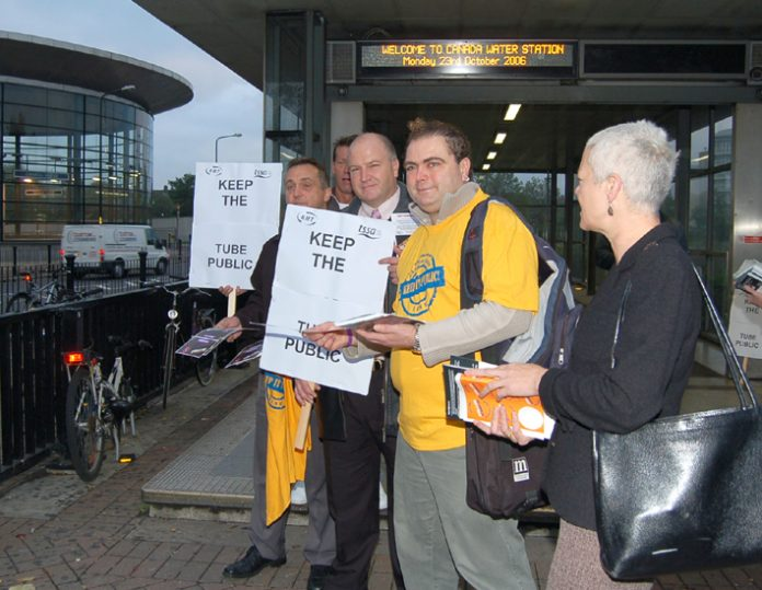 RMT leader BOB CROW (centre holding placard) campaigning against the privatisation of the East London tube Line