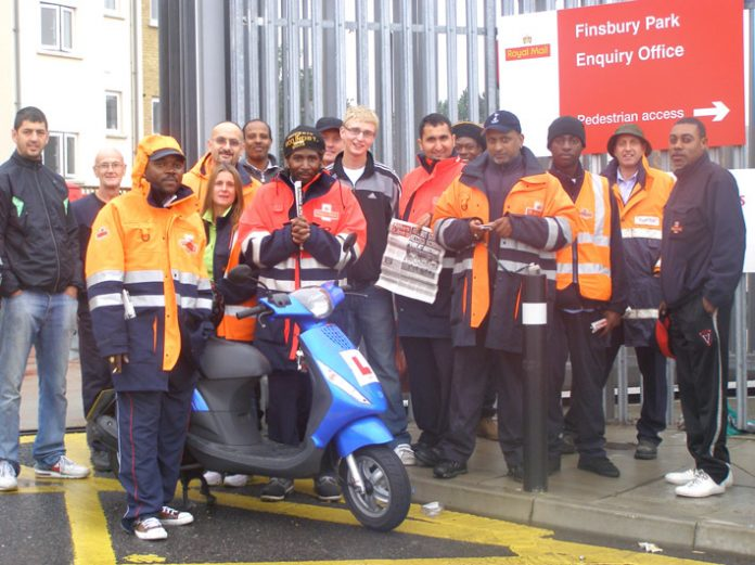 Confident pickets at Finsbury Park office in Green Lanes yesterday morning