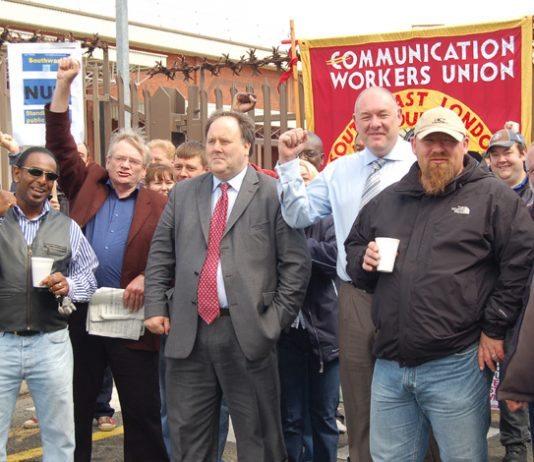 CWU leaders BILLY HAYES and DAVE WARD (centre) on the picket line at Mandela Way, south east London last Friday