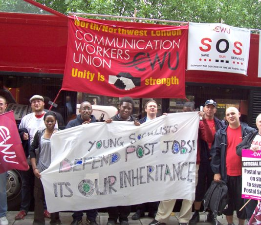 Postal workers supported by Young Socialists demonstrate outside the Royal Mail headquarters in Old Street yesterday at midday